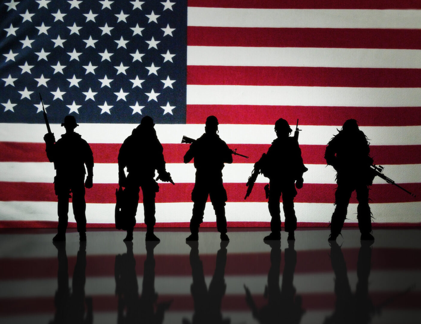 A silhouette of American soldiers
