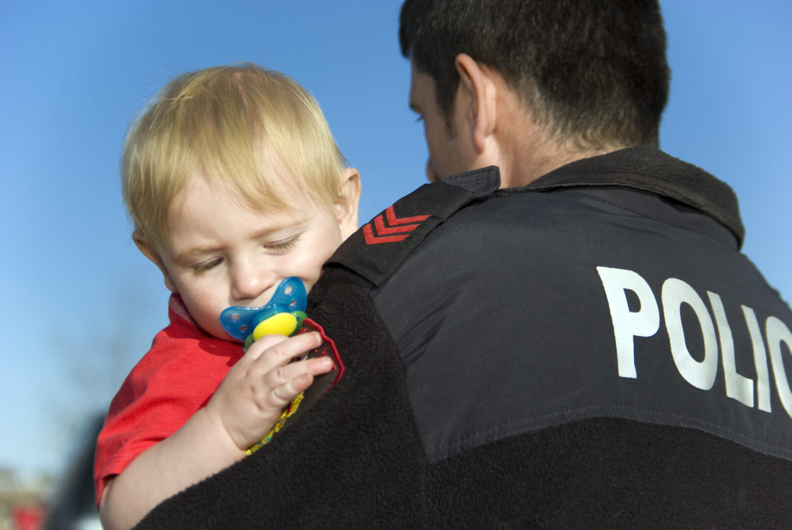 A police carrying a toddler
